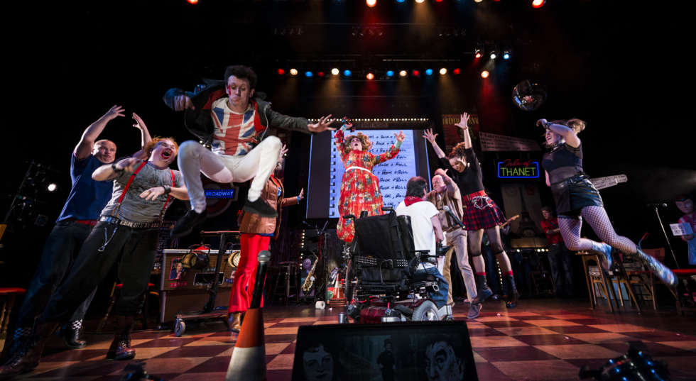Reasons to be Cheerful cast jumps on stage