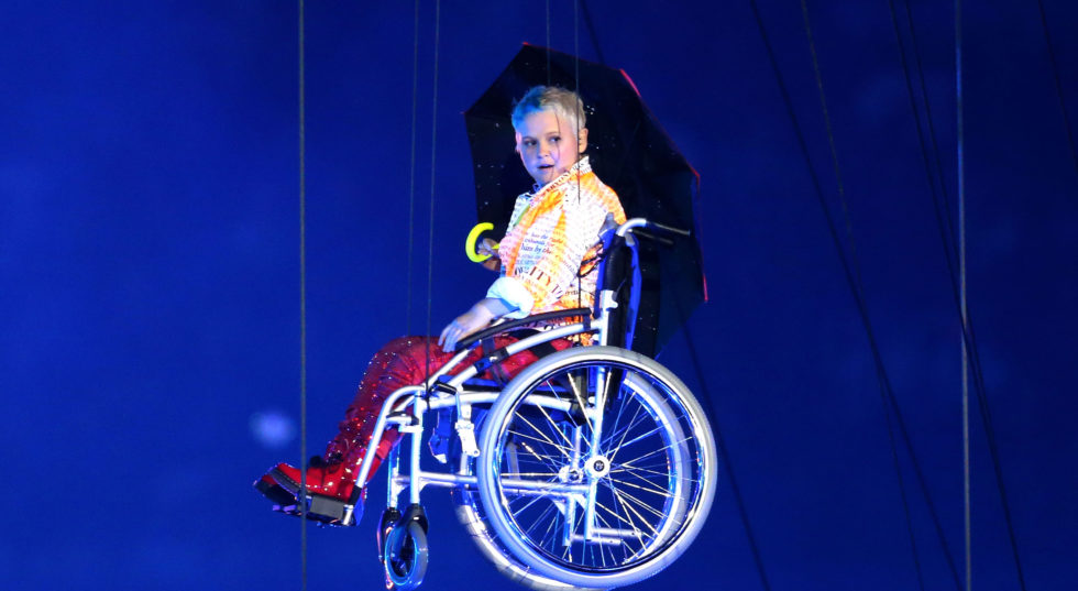 Image of Nicola Miles-Wildin in the air at the Paralympics opening ceremony