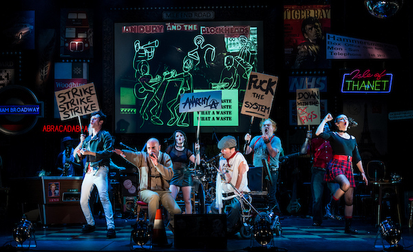 """Graeae Theatre Company. """"Reasons To Be Cheerful"""" cast protest on stage."""