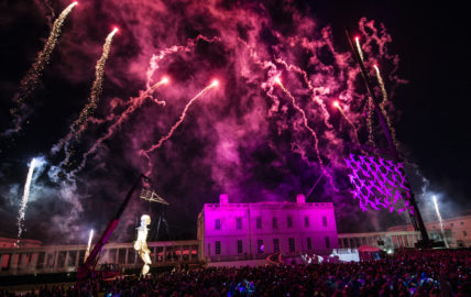 Image of the Queens House surrounded by fireworks