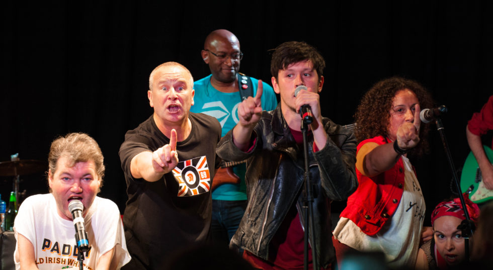 Image of cast on stage from Reasons to be Cheerful