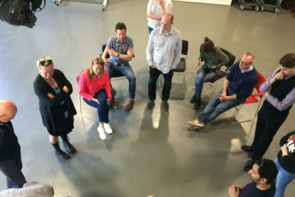 Image of Graeae team and participants in a circle talking