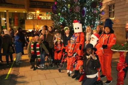 Image of people dressed as elves and Santa.