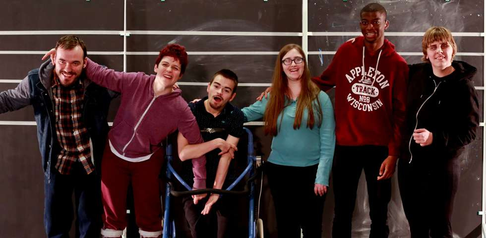Image of Graeae's Ensemble artists, standing in a row