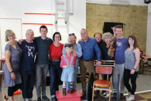 Reasons to be Cheerful cast standing with Jemima Dury