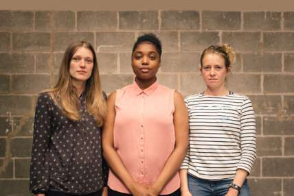 A photo of Genevive Barr, Lara Steward and Alexandra James, all standing against a brick wall looking straight to camera.